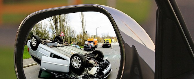 Crashed car in mirror